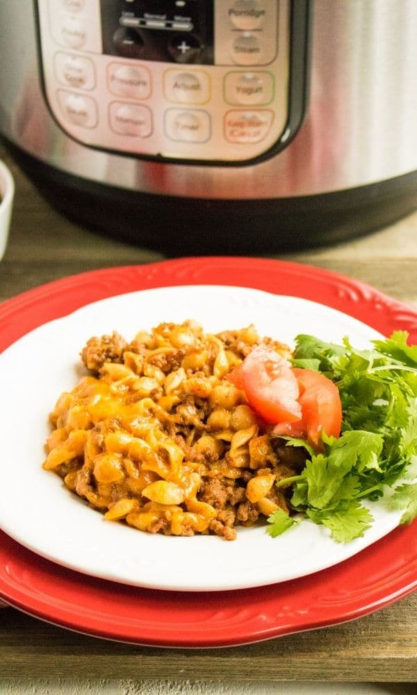 plate with taco pasta with instant pot behind it
