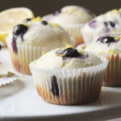 blueberry lemon muffins on a cake stand
