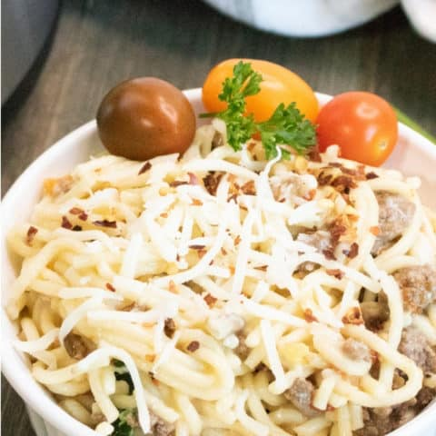 heirloom tomato pasta with ground beef in a bowl