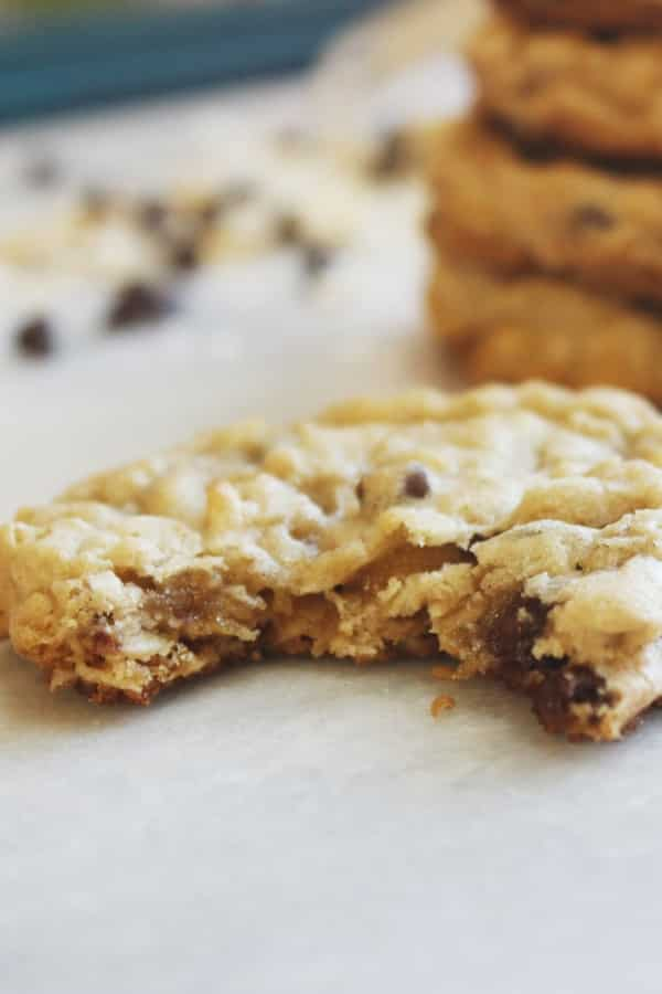 coconut chocolate chip cookies with bite out of it