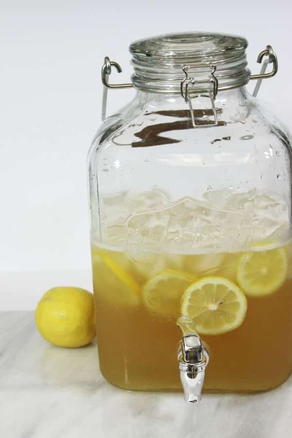 summer beer in glass jar with lemons