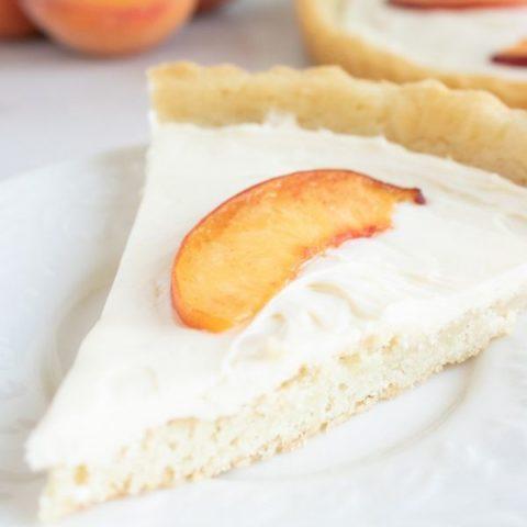 slice of peach tart on table