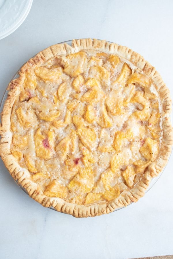 whole peach pie on counter
