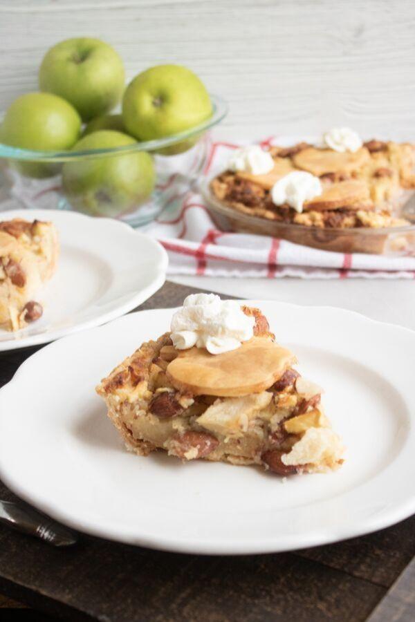 apple almond pie sliced on plates