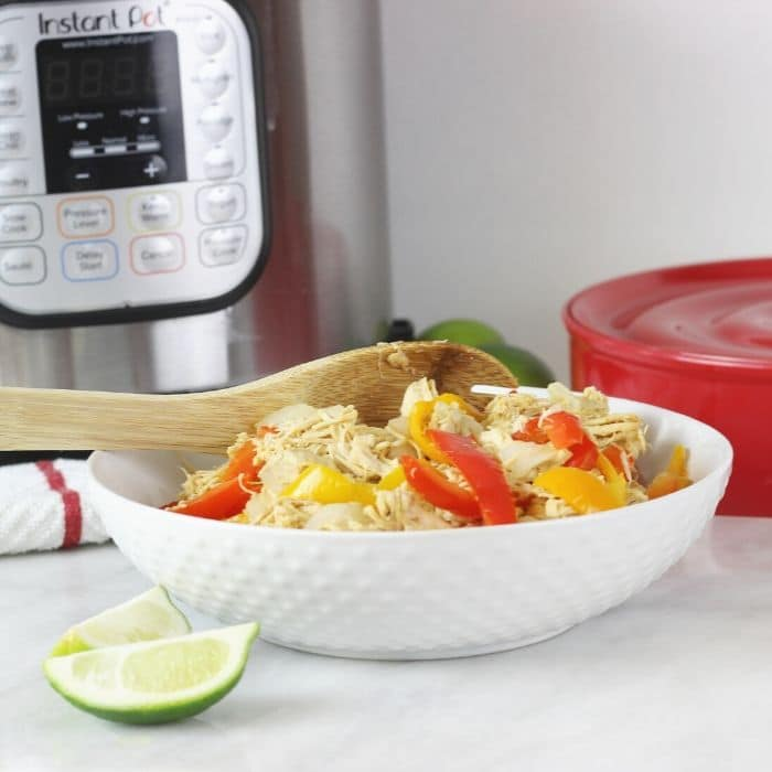 Instant Pot Chicken Fajitas is an easy chicken fajita recipe loaded with perfect spices, tender onions, peppers and so easy to pull together. #instantpot #pressurecooker #chicken #fajitas #homemade #fromscratch #freezermeal #mealprep #easy #flourtortillas #limejuice #recipe #dinner #weeknight #weekday #meal #idea