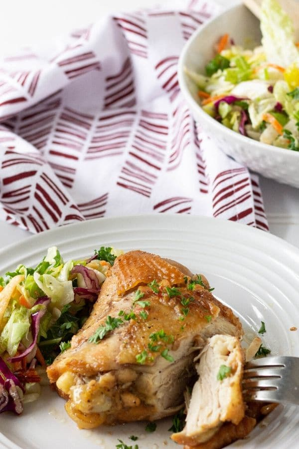 chicken dinner on plate with salad