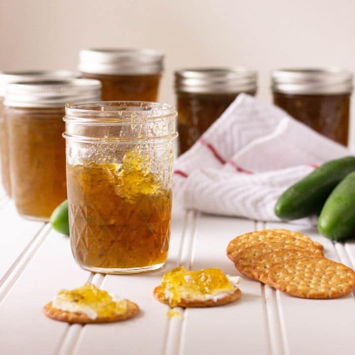 easy pepper jelly in a jar with crackers in front