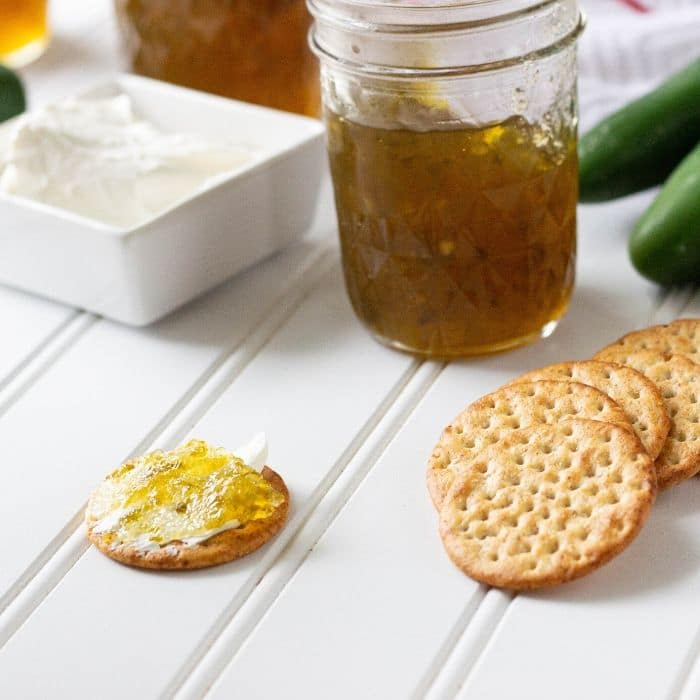 instant pot jelly with crackers and cream cheese smothered crackers on side