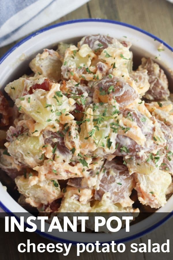 red potato salad with cheese and bacon in bowl