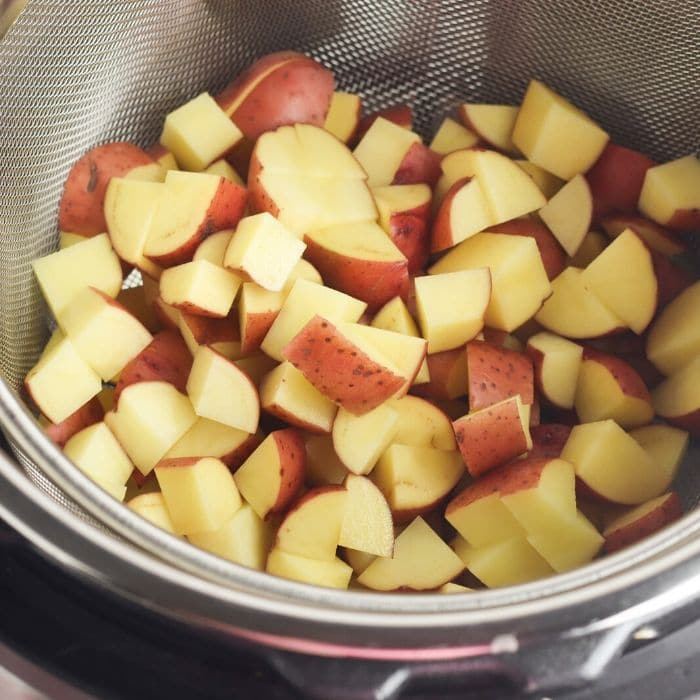 red potatoes diced and sitting in instant pot