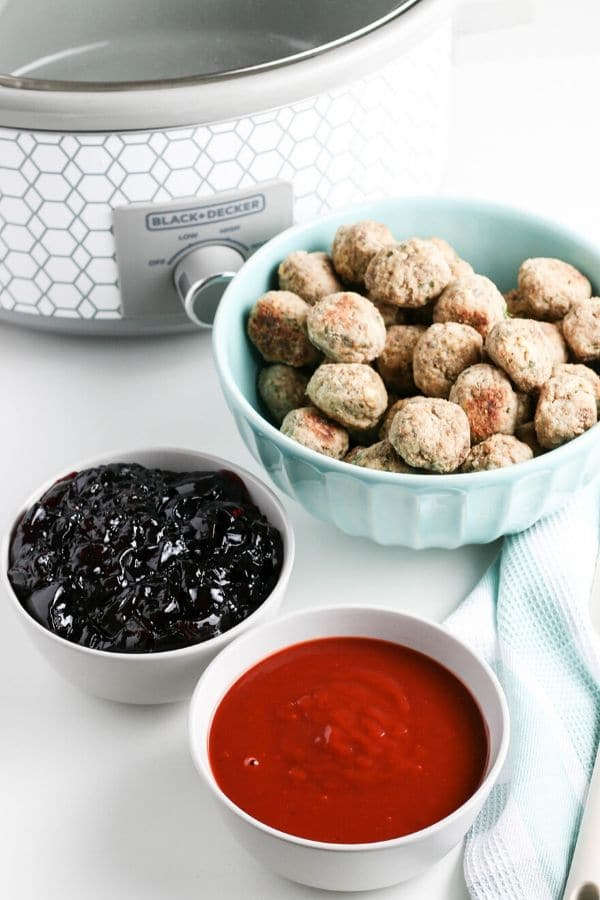 meatball appetizer with ingredients by it in a bowl