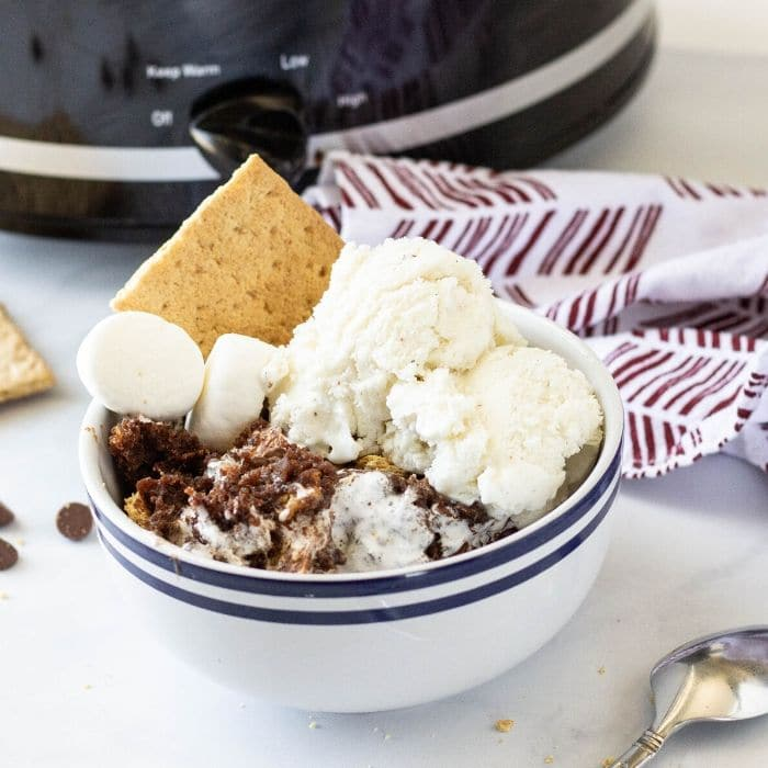 smores cake in a bowl with ice cream
