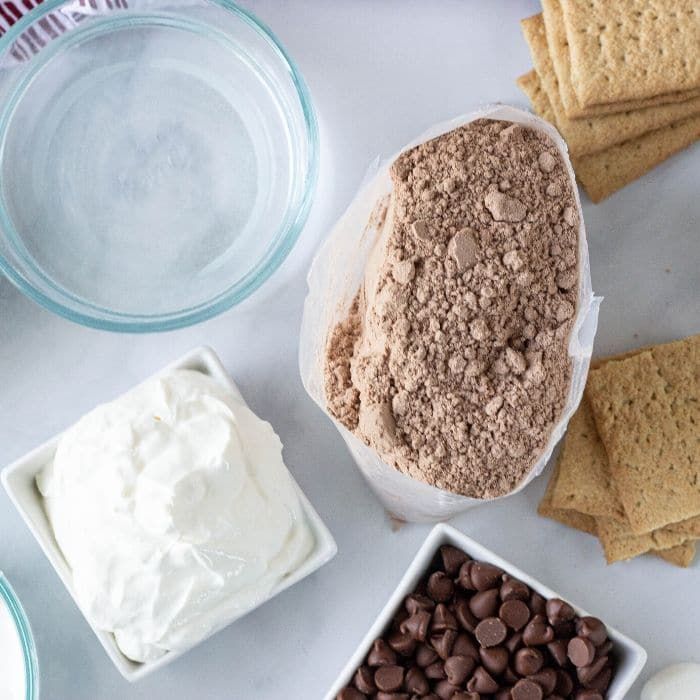 smores cake ingredients on a marble table