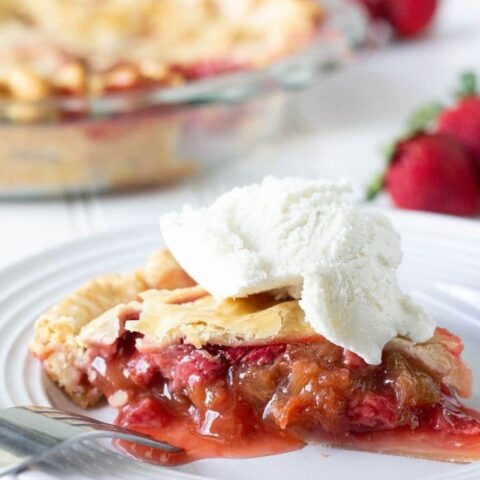 strawberry rhubarb pie on plate with ice cream