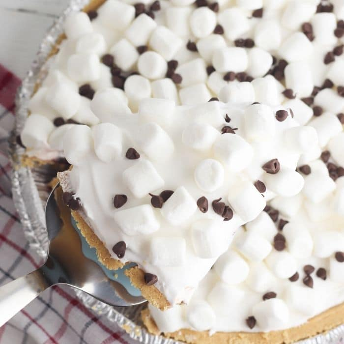 taking a slice out of the no bake smores pie