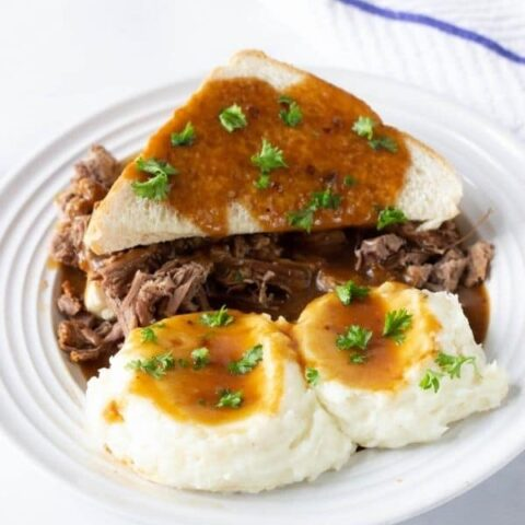 hot roast beef sandwich on a plate with mashed potatoes
