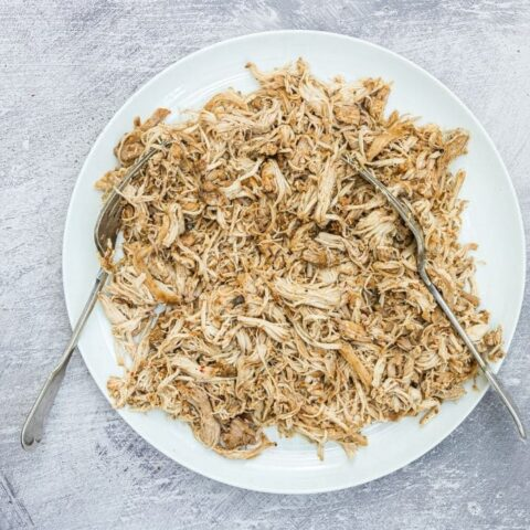 shredded chicken on a plate with two forks