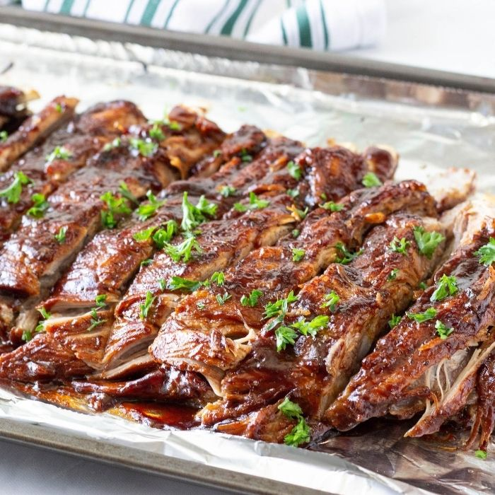 instant pot ribs on an aluminum foil lined pan