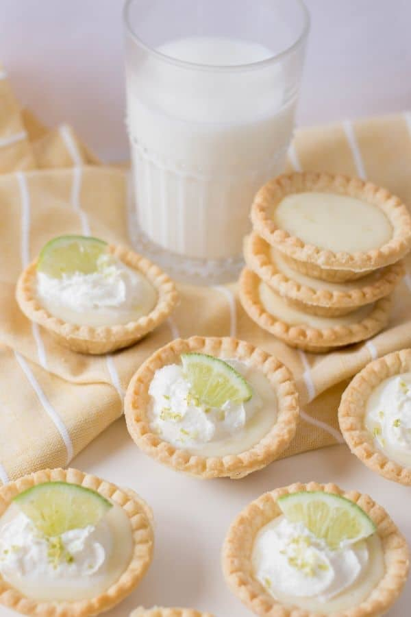 lime pies on table with milk by it