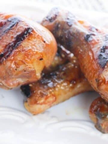 chicken leg huli huli on a white platter