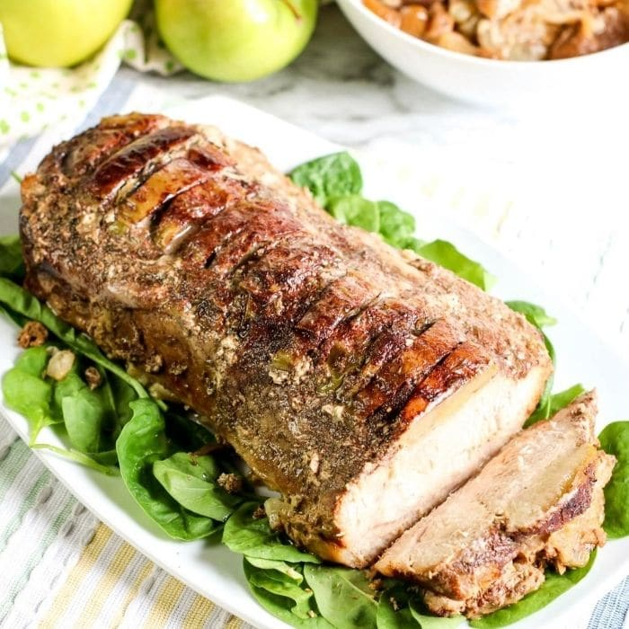 crockpot pork loin on platter with greens