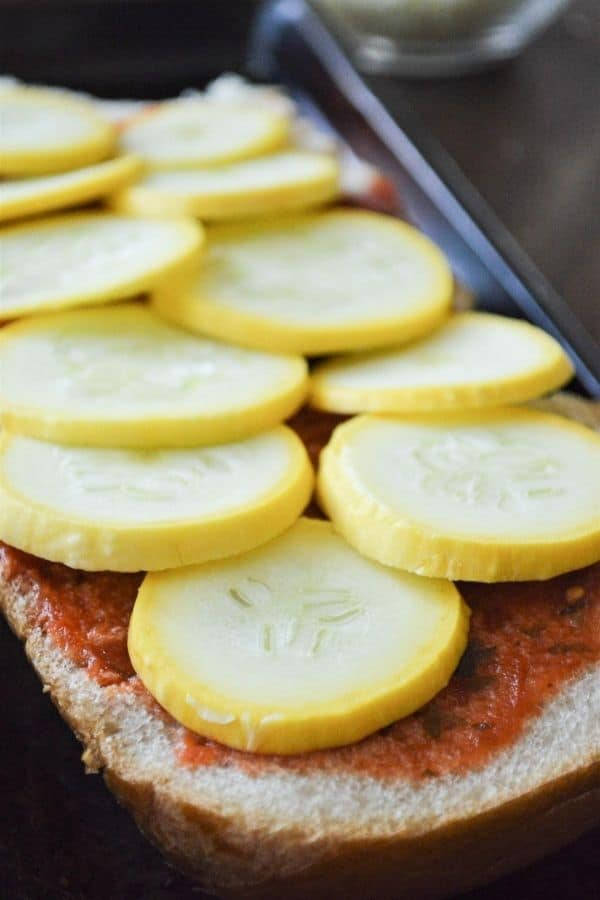 sliced summer squash on french bread pizza