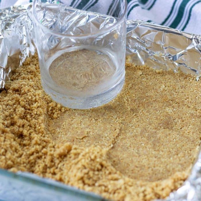 packing graham cracker crust down