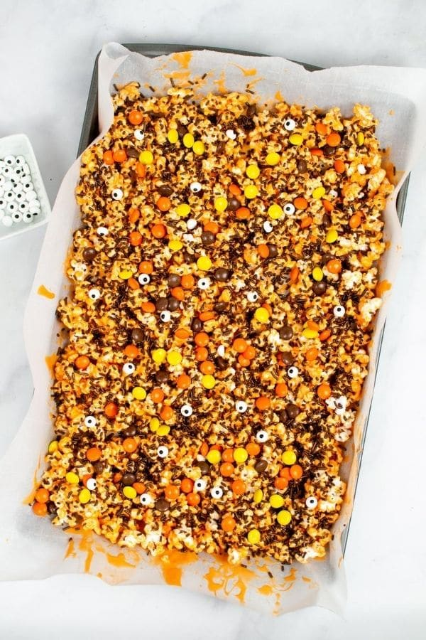 Halloween popcorn mix on sheet pan