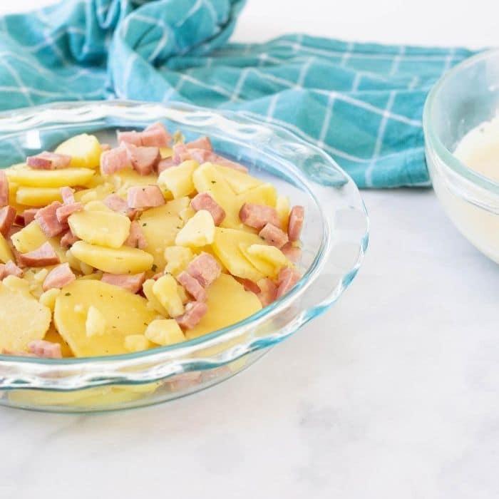 potatoes and ham in baking pan
