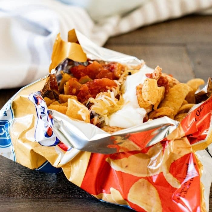 shredded chicken walking taco in frito bag on counter