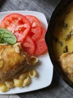 skillet chicken with a plate by it