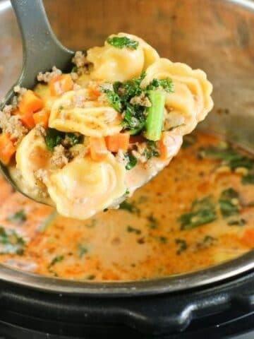 tortellini soup in a ladle in instant pot