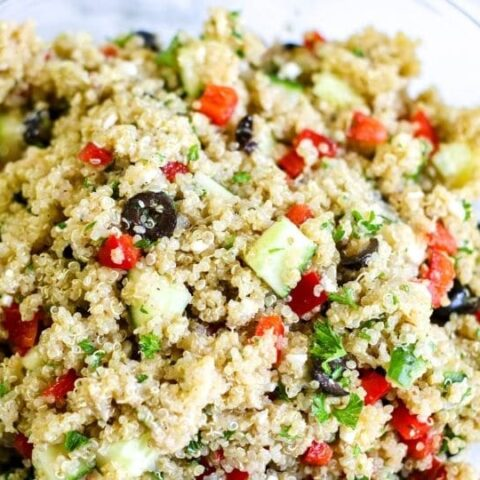 quinoa salad in a glass bowl on table