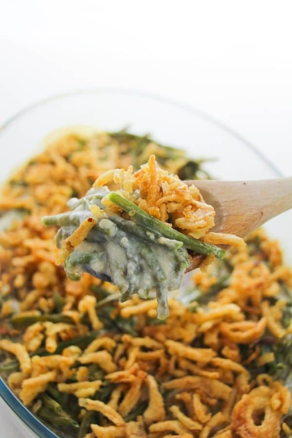 wooden spoon holding green bean casserole