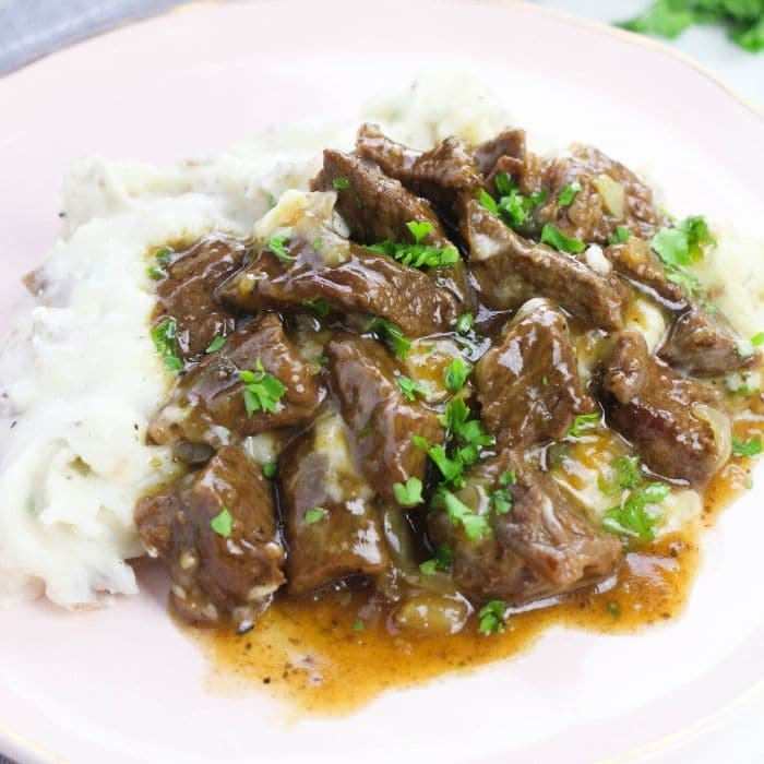 plate of potatoes and beef and gravy