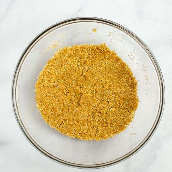 graham cracker crust mixture in bowl