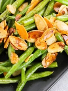 plate of green beans with toasted almonds on top