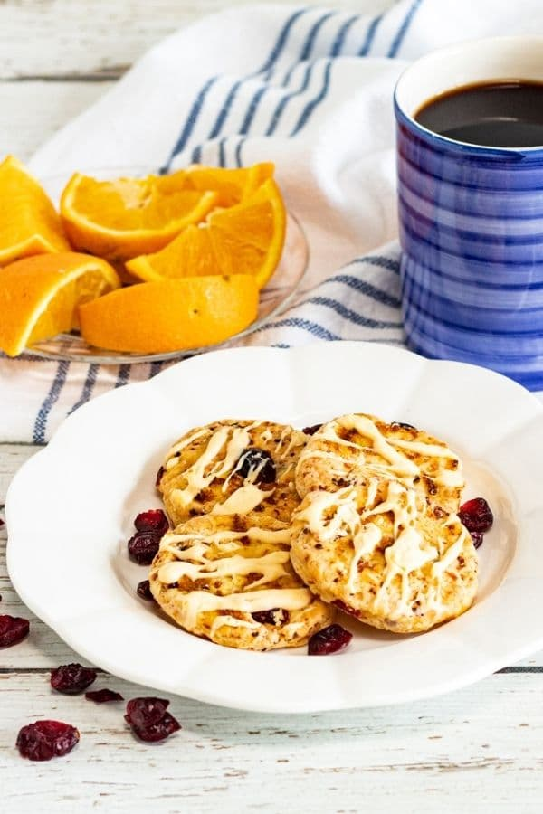 plate of cookies, orange slices and coffee by it