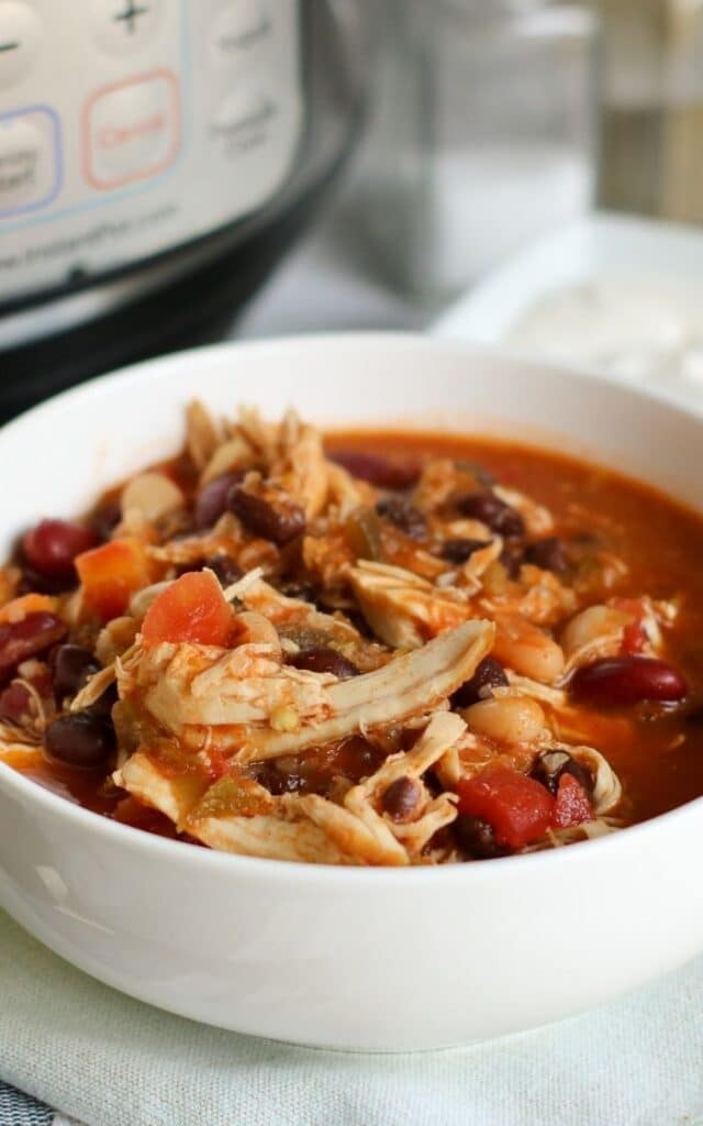side view of a bowl of chicken chili with beans
