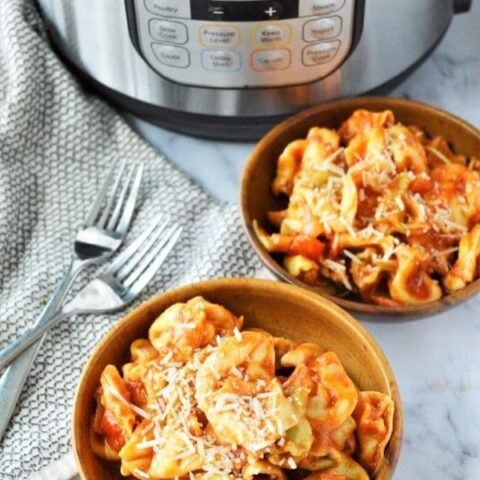 bowls of pasta with instant pot behind the bowls
