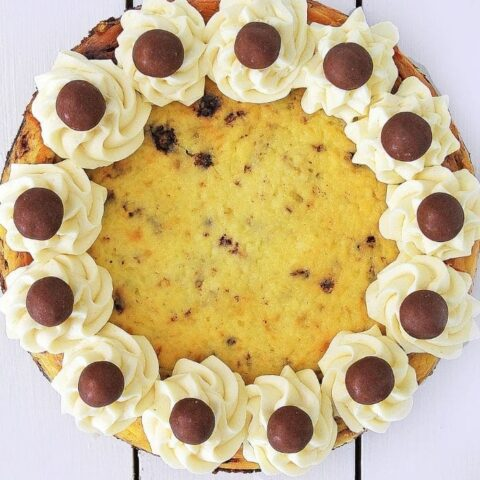 whole cheesecake on a table decorated