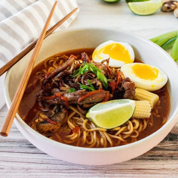 bowl of pork ramen with chopsticks