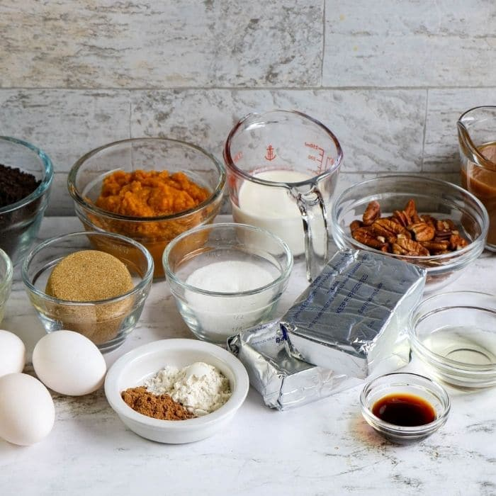 ingredients for pumpkin turtle cheesecake on counter