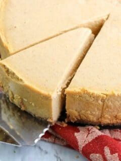 pumpkin spice cheesecake with removing a slice