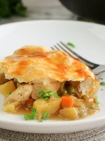 pot pie on a white plate with fork