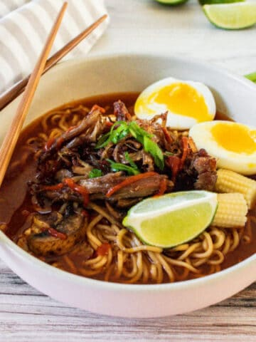top ramen in a bowl with chopsticks by it