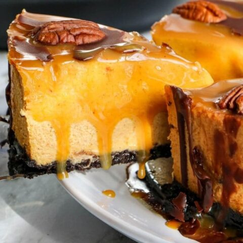 slice of turtle cheesecake coming out of whole cheesecake