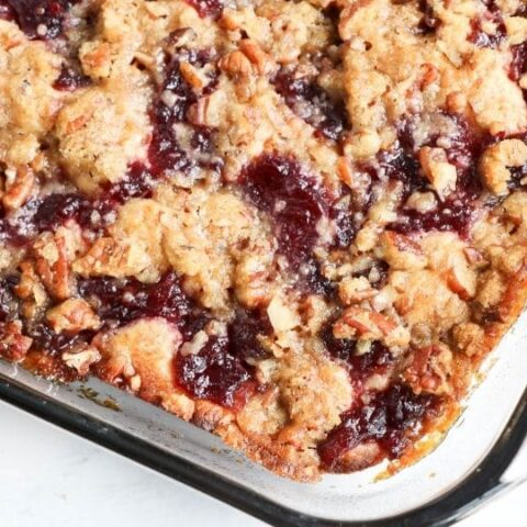 banana cranberry coffee cake in a glass container