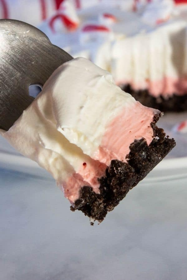 fork with layered peppermint dessert on it