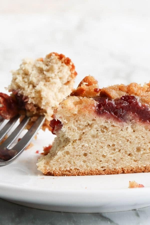 cranberry banana coffee cake on a plate with a fork